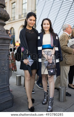 PARIS - OCTOBER 5, 2016: Stylish Asian woman at Vendome Square during Paris Fashion week. With Fashion week in New York, London and Milan, they are the four biggest fashion events in the world.