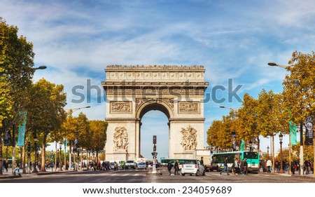 PARIS - OCTOBER 10: The Arc de Triomphe de l'Etoile on October 10, 2014 in Paris, France. It's one of the most famous monuments in Paris and stands in the centre of the Place Charles de Gaulle. - stock photo