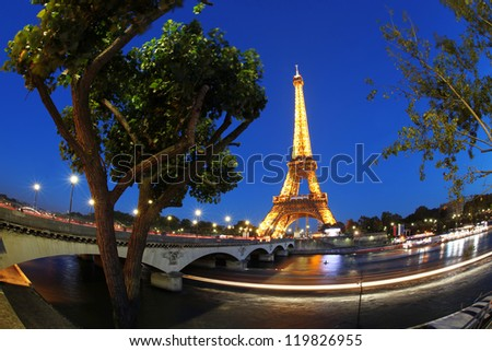 PARIS - OCTOBER 12:The Eiffel Tower from below upwards in the evening on October 12, 2012 in Paris, France.The Eiffel Tower lit by more than 350 lamps mounted within the structure of the tower itself. - stock photo