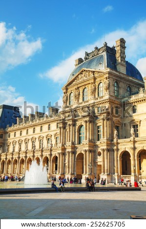 PARIS - OCTOBER 9: The Louvre museum on October 9, 2014 in Paris, France. The Louvre Museum is one of the world's largest museums and a historic monument and a central landmark of Paris. - stock photo