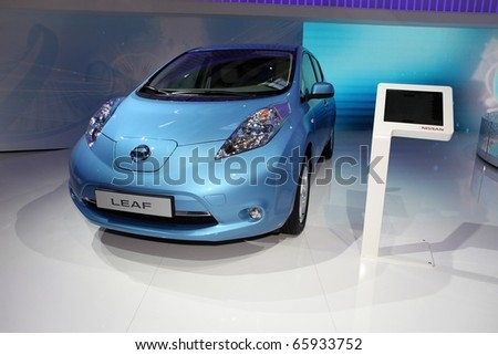 PARIS - OCTOBER 12: The new Nissan Leaf displayed at the 2010 Paris Motor Show on October 12, 2010 in Paris - stock photo