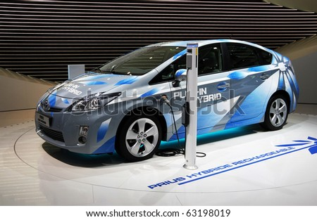 PARIS - OCTOBER 11: The Toyota Prius Plug-in Hybrid rechargeable automobile is displayed at the Paris Motor Show 2010 at Porte de Versailles, on October 11, 2010 in Paris, France - stock photo