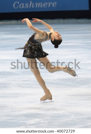 PARIS - OCTOBER 16: Yu-Na KIM of Korea performs at ladies short skating event of the ISU Grand Prix Eric Bompard Trophy on October 16, 2009 at Palais-Omnisports de Bercy, Paris, France. - stock photo
