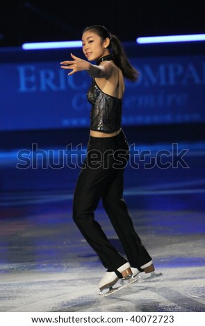 PARIS - OCTOBER 18: Yu-Na KIM of Korea performs at the Gala event of the ISU Grand Prix Eric Bompard Trophy October 18, 2009 at Palais-Omnisports de Bercy, Paris, France. - stock photo
