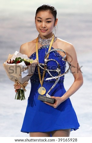PARIS - OCTOBER 17: Yu-Na KIM of Korea poses during medal ceremony winning gold at Eric Bompard Trophy at Palais-Omnisports de Bercy October 17, 2009 in Paris. - stock photo
