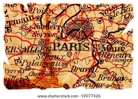 Paris on an old torn map with the eiffel tower, isolated. Part of the old map series. - stock photo