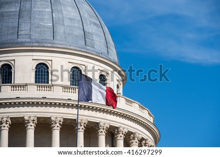 Paris Pantheon capitol dome with french waving flag