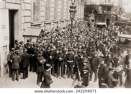 Paris police hold back a crowd making a run on a French bank. Ca. 1905-1915.