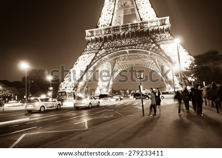 PARIS - SEP 08: area near Eiffel tower at night on September 08, 2014 in Paris, France. The Eiffel tower is the most visited monument of France. - stock photo