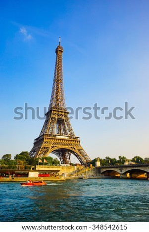PARIS - SEP 08: Eiffel Tower at Paris downtown on September 08, 2014 in Paris, France. Paris, aka City of Love, is a popular travel destination and a major city in Europe - stock photo