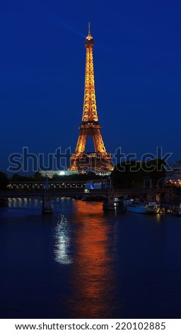 PARIS - SEP 27: The illuminated Eiffel Tower on Sep 27, 2014 in Paris, France.The Eiffel tower is most visited monument of France with 6 million visitors every year