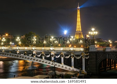PARIS - SEPTEMBER 25, 2013: Alexandre III bridge and Eiffel tower at night in Paris - stock photo