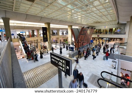 PARIS - SEPTEMBER 2014: Busy travellers at Charles De Gaulle Airport on September 15 2014 in Paris, France - stock photo