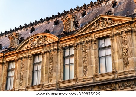 PARIS - SEPTEMBER 20, 2013: Detail of the exterior of the Louvre. The Louvre is one of the largest museums in the world and one of the major tourist attractions of Paris. - stock photo