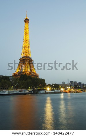 PARIS - SEPTEMBER 30: Eiffel Tower illuminated at night on September 30, 2012. The Eiffel tower is the highest monument and also most visited monument of France.