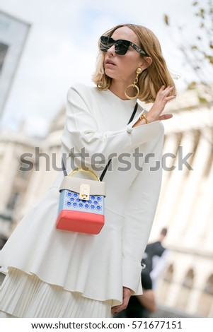 PARIS-SEPTEMBER 30, 2016. Famous Argentine blogger Candela Novembre is going to a fashion show. Paris fashion week, Ready to wear.