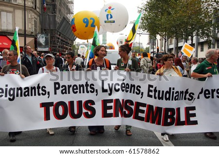 PARIS - SEPTEMBER 23: French teachers and students demonstrate during nationwide strike against raise of the retirement age from 60 to 62 at Place de La Bastille on September 23, 2010 in Paris, France - stock photo