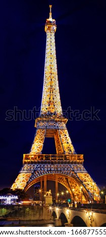 PARIS - SEPTEMBER 18: Light Performance Show on September 18, 2013 in Paris. The Eiffel Tower stands 324 metres (1,063 ft) tall. Monument was built in 1889, night view of the Siene River - stock photo
