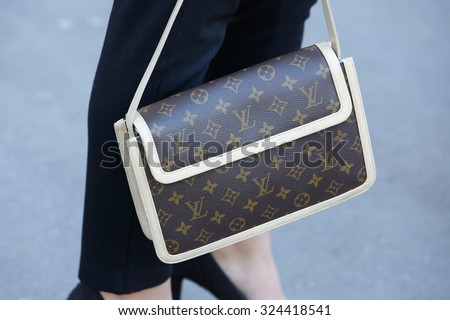 PARIS - SEPTEMBER 30: Louis Vuitton bag before Rochas show, Paris Fashion Week Day 2, Spring / Summer 2016 street style on September 30, 2015 in Paris.
