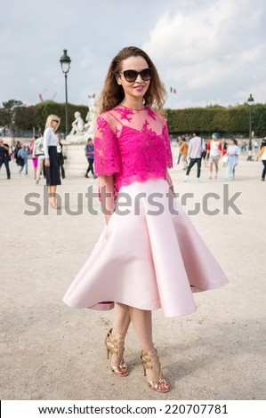 PARIS - SEPTEMBER 30, 2014: Stylish european woman with pink dress in the Tuileries Garden. Paris Fashion Week: Ready to Wear 2014/2015 is held from September 23 to October 1, 2014. - stock photo