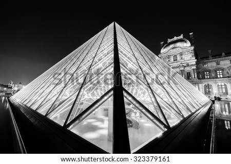 PARIS - SEPTEMBER 06: The Louvre Palace and the Pyramid on September 06, 2014 in Paris, France. The Louvre or the Louvre Museum is one of the world's largest museums and a historic monument. - stock photo