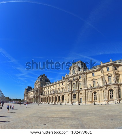 Paris, September 8: The world-famous Louvre - September 8, 2012 in Paris. Tourists take pictures of the glass pyramid entrance. Traces in the sky jet. Picture taken Fisheye lens - stock photo