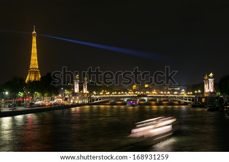 PARIS - SEPTEMBER 25: View of Alexandre III bridge and Eiffel tower on september 25, 2013 in Paris. Alexandre III bridge is one of the top tourist destinations in Paris. - stock photo