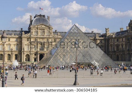 PARIS - SEPTEMBER 15: View of the Pyramid that acts as entrance to Louvre museum on September 15, 2014 in Paris, France - stock photo