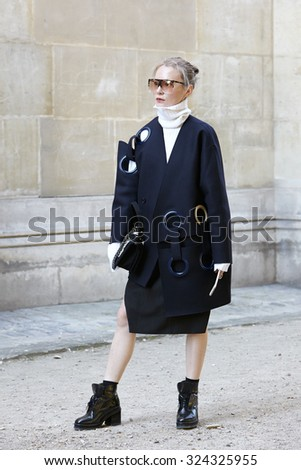 PARIS - SEPTEMBER 30: Woman poses for photographers before Yang Li show, Paris Fashion Week Day 2, Spring / Summer 2016 street style on September 30, 2015 in Paris. - stock photo