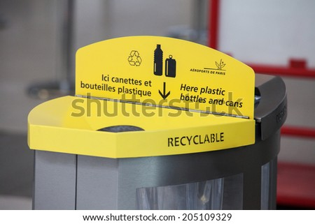 Paris, September 28: Yellow plastic trash for plastic bottle for recyclation in Paris airport. Paris, France shutterd on 28.09.2013 - stock photo