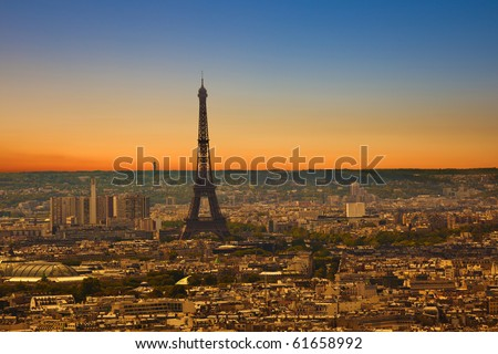 Paris skyline from the Sacre Coeur at a summer sunset. Eiffel tower area view - stock photo