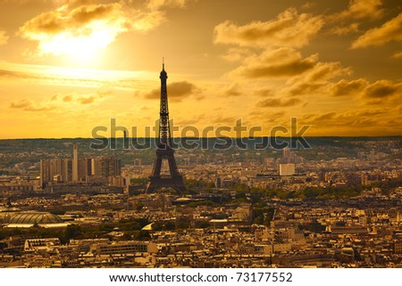 Paris skyline from the Sacre Coeur at sunset. Eiffel tower area focused - stock photo