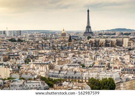 Paris skyline with Eiffel Tower at sunset - stock photo