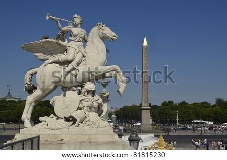 Paris, statue and Obelisk on Place de La Concorde - stock photo