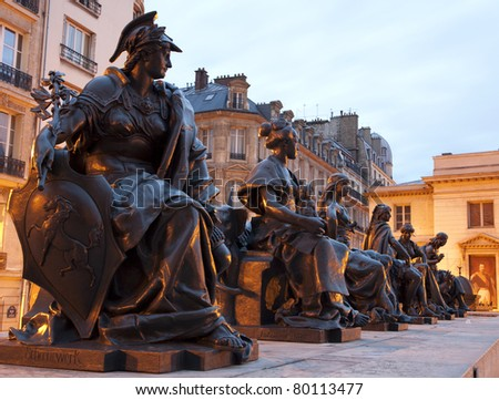 Paris - statue of virtues by  Le Musee d'Orsay - stock photo