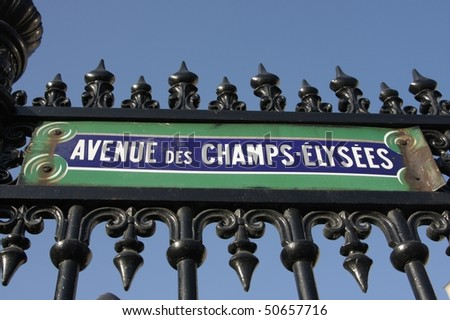 paris street signs and indication in the city,  the avenue des champs elysees - stock photo