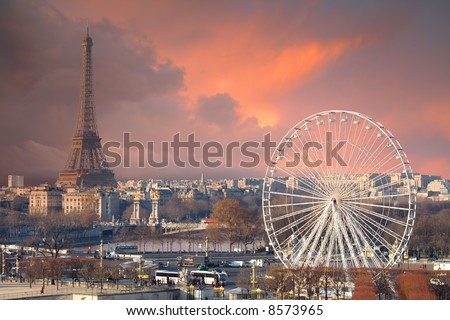 Paris under a thunder-charged sky. Eiffel tower and big wheel, separated by the Seine river and Alexandre III Bridge.