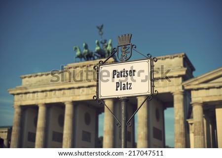 Pariser Platz sign and Brandeburg Gate (Brandenburger Tor), Berlin, Germany, Europe, vintage style - stock photo