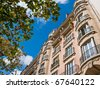 Parisian Apartment with Tree in Foreground - stock photo