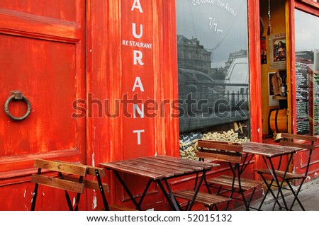 Parisian bistro at the start of the day - stock photo