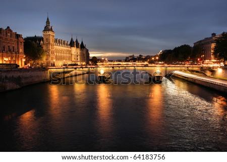 Parisian bridge at night - stock photo