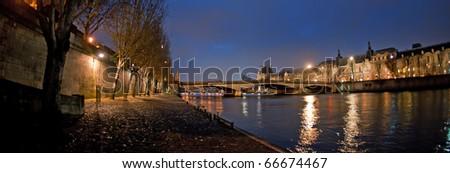 Parisian bridge by night - stock photo