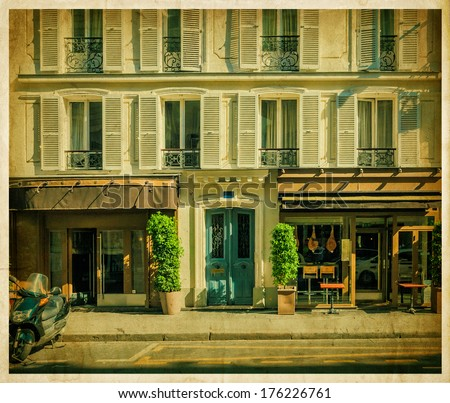 Parisian facade of house with the old cafe. Vintage photo - stock photo