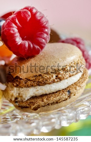 Parisian macarons, raspberries and other delicacy. Closeup