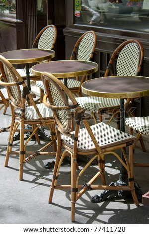 Parisian restaurant terrace during a sunny day in spring - stock photo