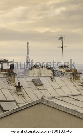 Parisian roofs in Paris, France. The Eiffel Tower in the background. / Paris rooftops - stock photo