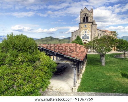 Park and Church of san vicente in the village of frias province of burgos, Spain
