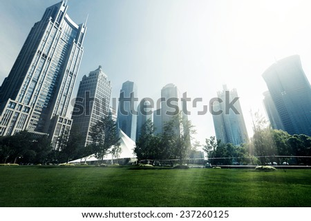 Park and modern building in Shanghai, China - stock photo