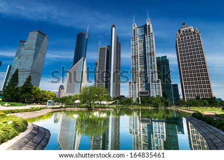 park and skyscrapers under the blue sky in shanghai