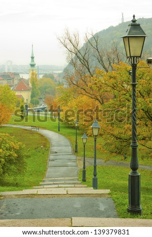 park at historical district of Budapest, view from medieval bastion, top of the hill in background another fortress, and the statue of liberty - stock photo